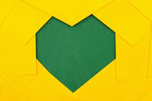 paper yellow papers forming green heart hole visit