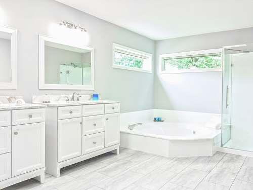bathtub white ceramic bathtub near white wooden vanity sink tub