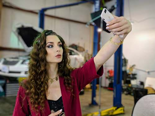 person selective focus photo of woman taking selfie sterling