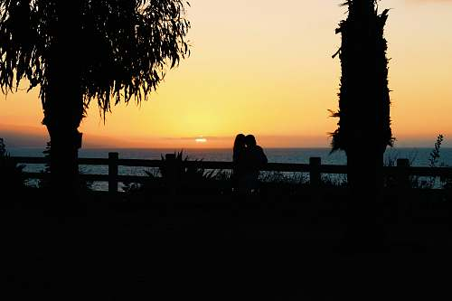 person silhouette of couple during sunset sunset