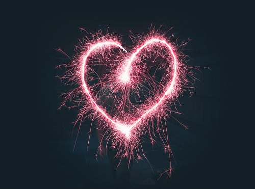 night heart shaped pink sparklers photography outdoors