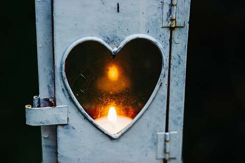 heart turned on candle lantern fire