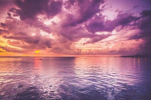 cloud ocean during golden hour pink