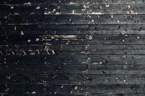 background closeup photography of black wooden parquet partition japan