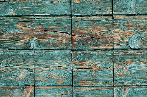 background Turquoise paint coming off square wooden planks pattern