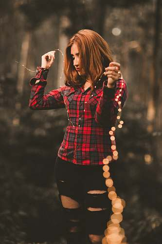 plaid woman in red and black dress shirt human