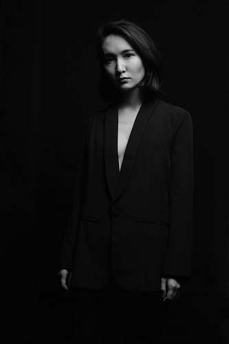 clothing grayscale photo of woman wearing black suit apparel