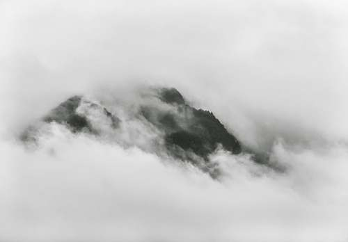 photo grey photo of mountain covered with mist mountain free for commercial use images