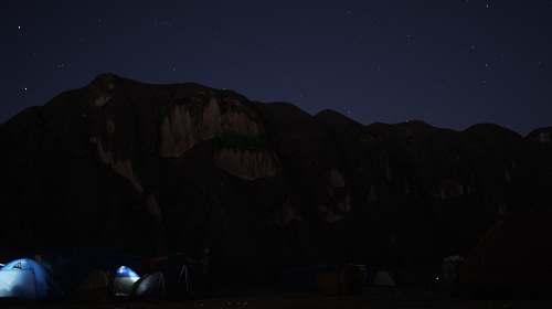 camping brown mountain at nighttime sky