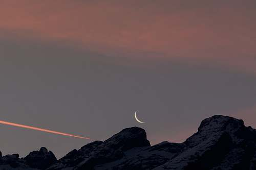 nature photo of black boulder and crescent moon moon