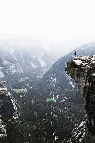nature man on mountain cliff valley