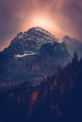 nature photo of mountain with trees in vicinity crest