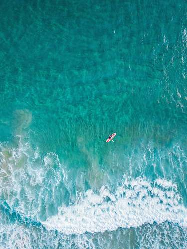 water aerial view of person at the boat on the ocean nature