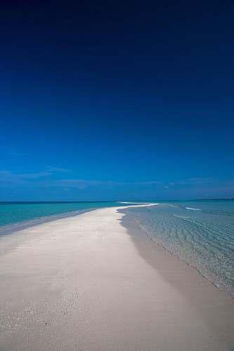 sea beach sand during daytime shoreline
