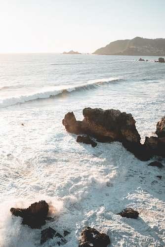 sea seawaves near mountain nature