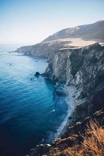ocean photo of cliff near shore cliff