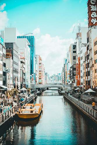 japan river in between street and high rise buildings canal
