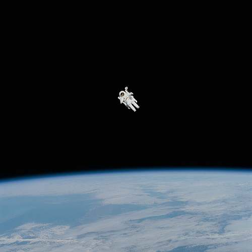 space astronaut in spacesuit floating in space universe