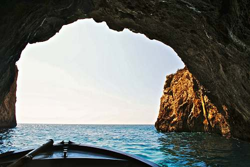 nature boat inside of water cave water