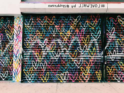 graffiti photo of black door shutter filled with heart murals love