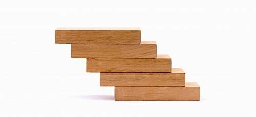 tabletop pile of brown wooden blocks furniture