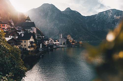 austria town beside body of water and mountains hallstatt