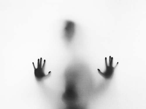 grey person behind fog glass halloween