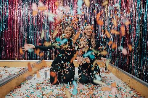 confetti two women enjoying confetti paper