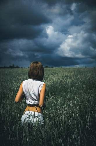 woman woman in sleeveless top on plants field female
