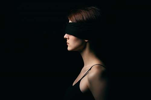 person woman wearing black blindfold facing sideways human