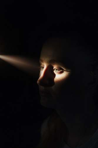 person woman's face with sunlight on eyes human