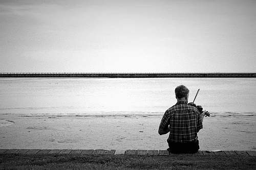 outdoors man playing violin on beach water
