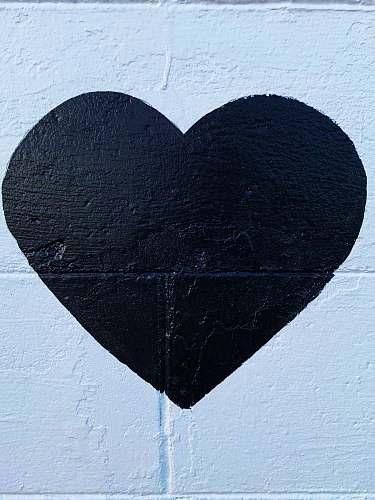 rug black heart printed concrete wall black