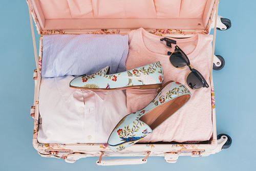 photo clothing items and pair of shoes in luggage free for commercial use images