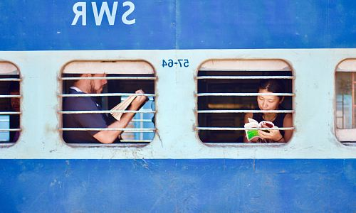 photo man and woman sitting on train free for commercial use images