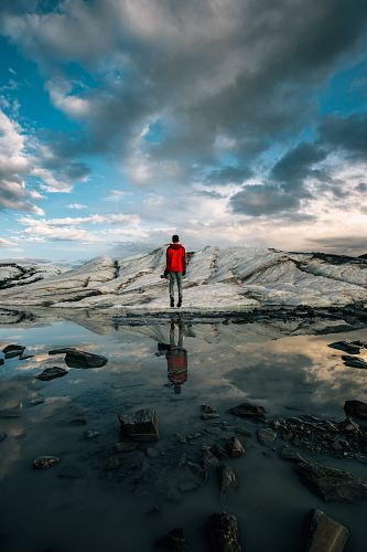 photo man standing near body of water of water free for commercial use images