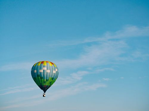 photo multi-colored hot air balloon flying on sky free for commercial use images
