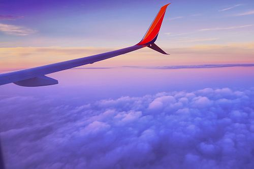 photo person in a plane flying at high altitude taking photo of left airplane wing during daytime free for commercial use images