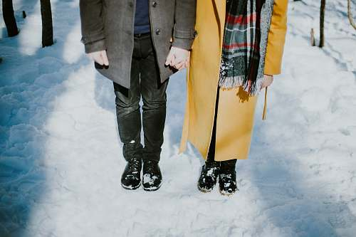 snow person standing beside each oter couple