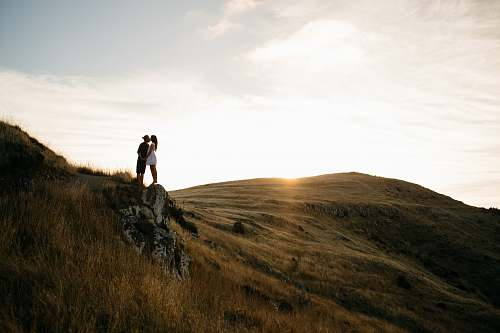 christchurch couple kissing on top of hill new zealand