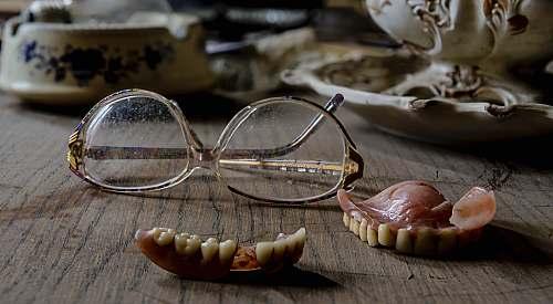 belgium eyeglasses near dentures cup