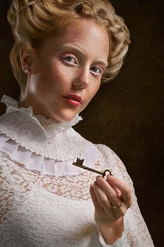 clothing woman holding skeleton key apparel