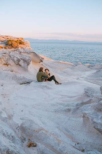 human man and woman on seashore greece