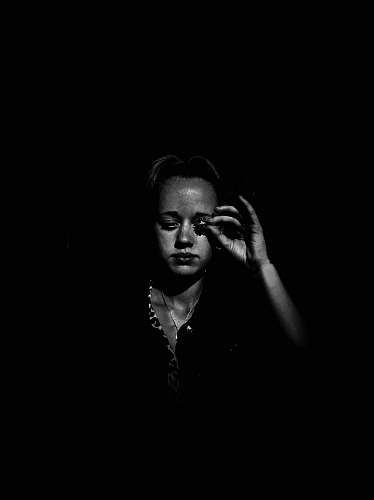 human grayscale photo of woman face