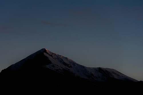 mountain mountain silhouette at golden hour peak
