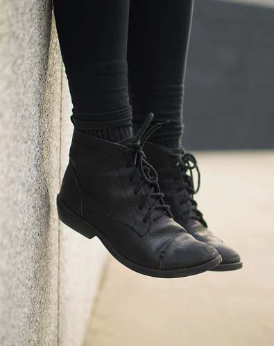 shoe person wearing black lace-up boots clothing