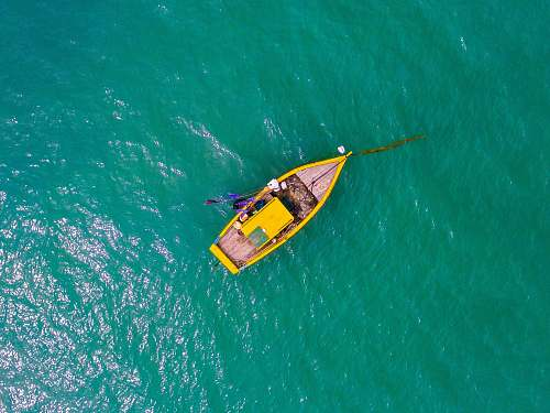 ocean aerial view photography rowboat on body of water boat
