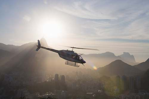 rio de janeiro gray and black helicopter under white cloudy sky during daytime transportation