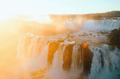 nature waterfalls photo during daytime waterfall
