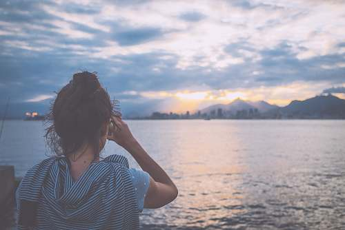 person woman standing near body of water during daytime people